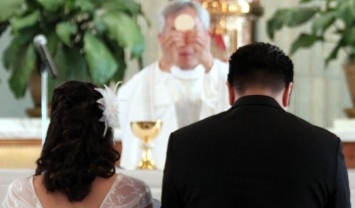 WeddingKneelingBeforeEucharist_crop