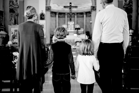 Family Praying Catholic Church