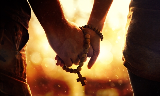 Couple Praying Rosary Holding Hands